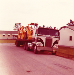 The second one was a black/white Kenworth Cabover.  This was bought in the early 70s, and check out that load of tractors.